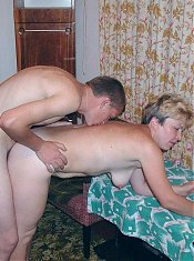 Naughty mature babe gets doggy style drilling in her ripe cooze from a grateful younger hunk