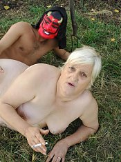 Cock greedy granny Mandy on her knees admiring a huge cock by working it with her lips live