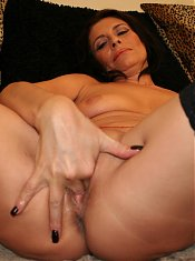 This horny cougar gets herself wet for you