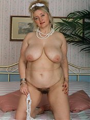 Blonde mature slut showing her luscious body
