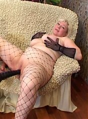 Mature babe Erica seduce her stud with her chubby pussy while wearing her fishnets